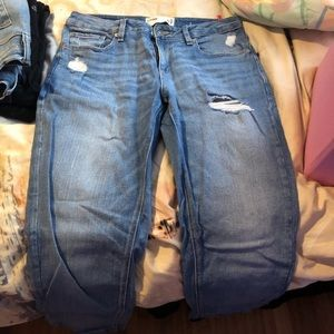 Two pairs of garage mid-waisted Capri jeans